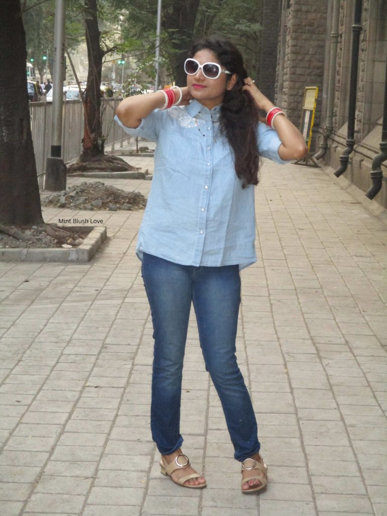 Chambray shirt outfit, denim on denim style, Oversized sunglasses lulu and sky, chooda, how to wear chooda with western outfits